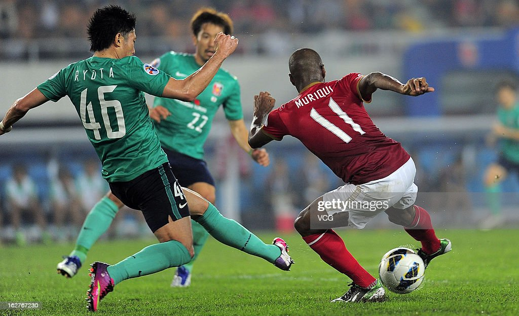 Muriqui (R) of Guangzhou Evergrande and Ryota Moriwaki (L) of Urawa Red Diamonds battle for the ball during the AFC Champions League match between Guangzhou Evergrande and Urawa Red Diamonds at Tianhe Sports Center on February 26, 2013 in Guangzhou, China.