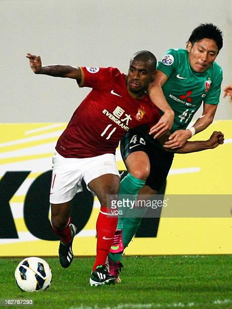 Muriqui of Guangzhou Evergrande and Ryota Moriwaki of Urawa Red Diamonds battle for the ball during the AFC Champions League match between Guangzhou...