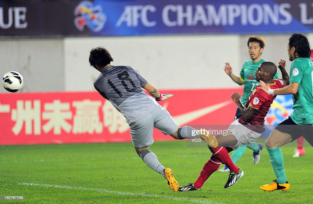 Muriqui of Guangzhou Evergrande scores his team's second goal during the AFC Champions League match between Guangzhou Evergrande and Urawa Red Diamonds at Tianhe Sports Center on February 26, 2013 in Guangzhou, China.
