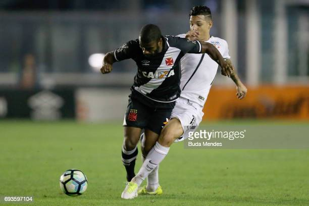 Muriqui of Vasco da Gama struggles for the ball with Giovanni Augusto of Corinthians during a match between Vasco da Gama and Corinthians as part of...