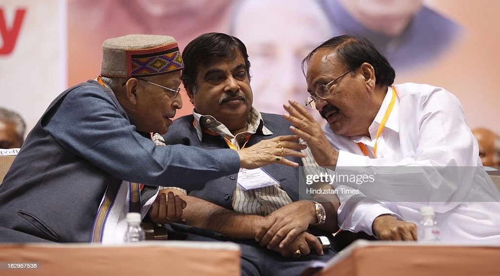 Murli Manohar Joshi talking with M Venkaiah Naidu as Nitin Gadkari listens during Bharatiya Janata Party National Council meeting at Talkatora Indoor Stadium on March 2, 2013 in New Delhi, India. In his 90 minute presidential address Rajnath Singh asked the party ranks to be prepared for early Lok Sabha polls and crucial assembly elections this year, including in Karnataka, Madhya Pradesh, Chhattisgarh, Rajasthan and Delhi all very important states for BJP.