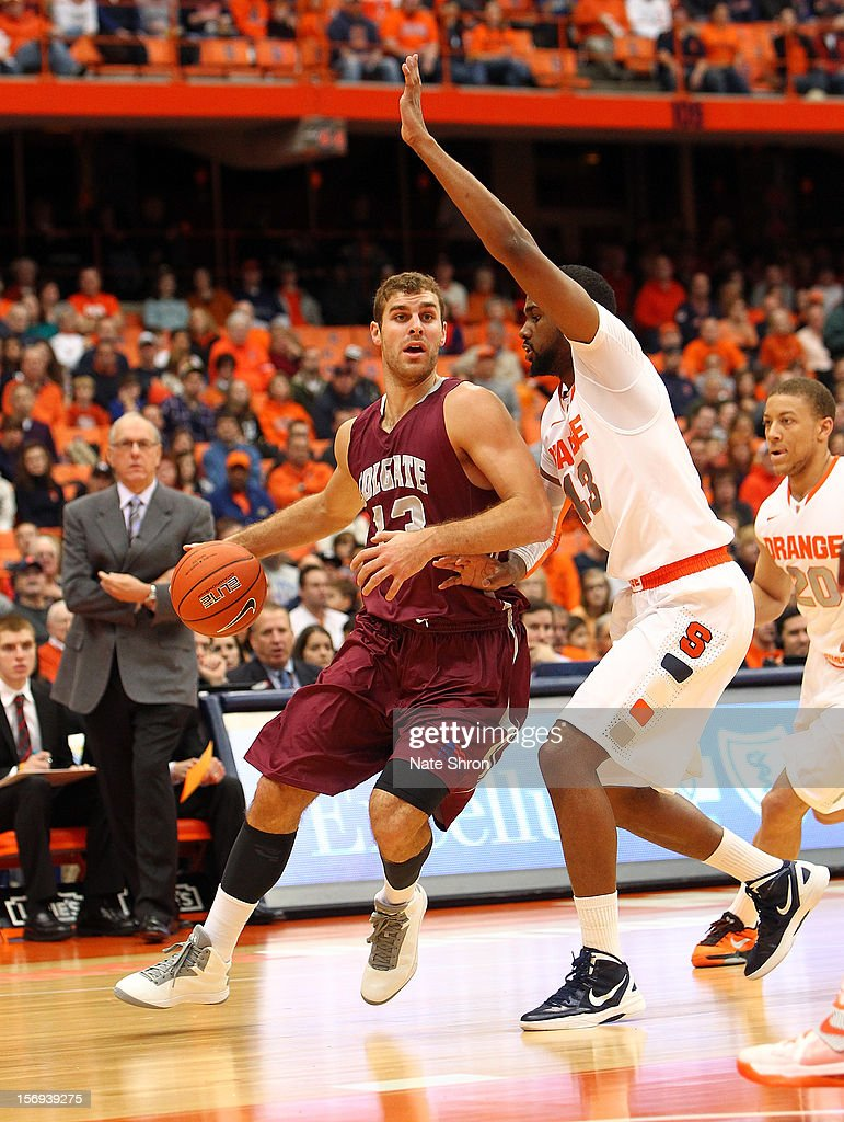 Murphy Burnatowski #13 of the Colgate Raiders drives the ball to the basket against James Southerland #43 of the Syracuse Orange during the game at the Carrier Dome on November 25, 2012 in Syracuse, New York.