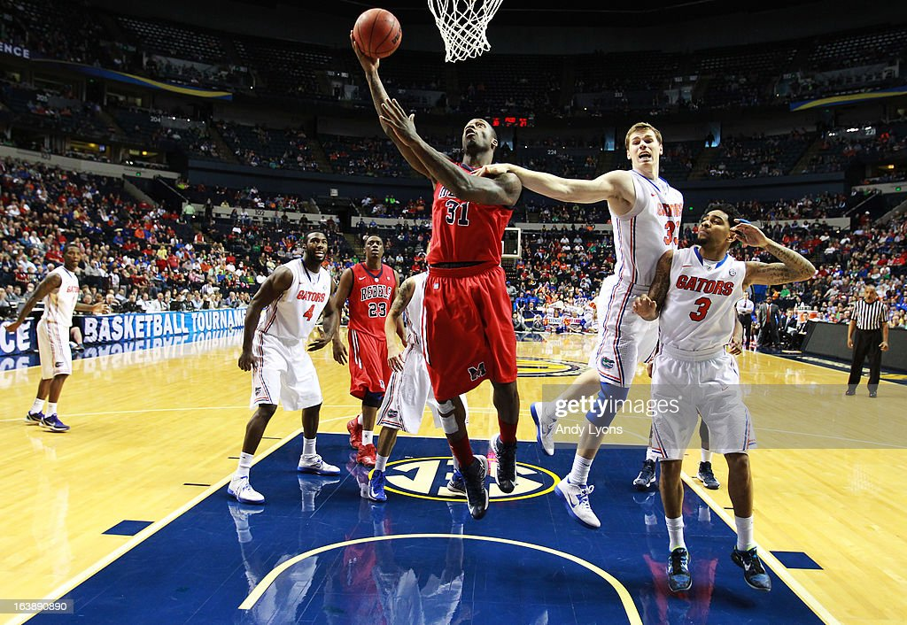 Murphy Holloway #31 of the Ole Miss Rebels goes up against Erik Murphy #33 of the Florida Gators in the second half of the SEC Basketball Tournament Championship game at Bridgestone Arena on March 17, 2013 in Nashville, Tennessee.