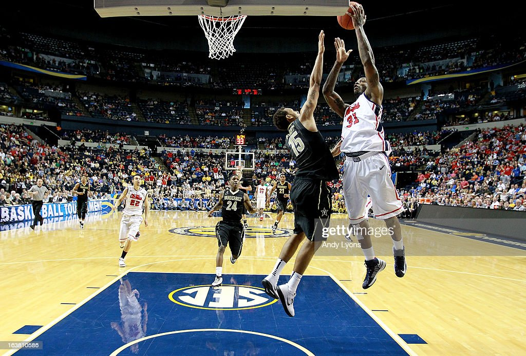 Murphy Holloway #31 of the Ole Miss Rebels shoots against Kevin Bright #15 of the Vanderbilt Commodores in the second half during the Semifinals of the SEC basketball tournament at Bridgestone Arena on March 16, 2013 in Nashville, Tennessee. Ole Miss won 64-52.