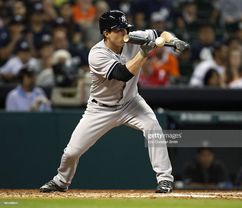 J.R. Murphy #66 of the New York Yankees bunts during the thirteenth inning against the Houston Astros on September 29, 2013 at Minute Maid Park in Houston, TX.