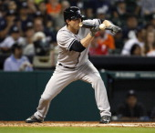 R Murphy of the New York Yankees bunts during the thirteenth inning against the Houston Astros on September 29 2013 at Minute Maid Park in Houston TX
