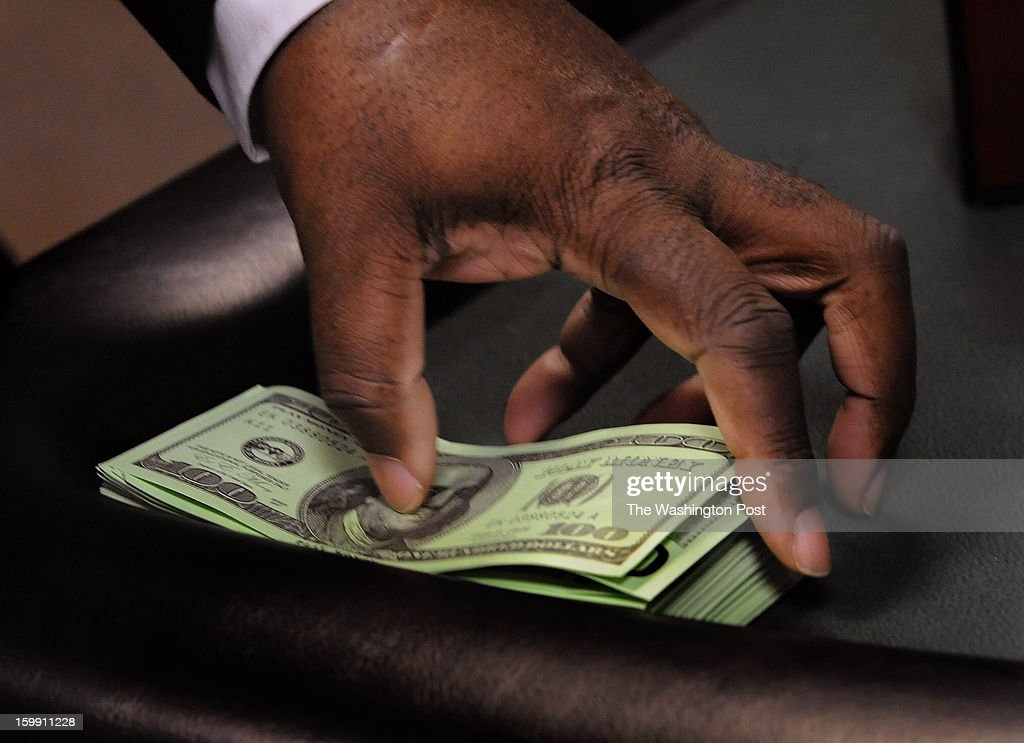 Murphy Payne of Silver Spring straightens a stack of fake 100 dollar bills as he takes his turn at the dealer position during a training session at the Black Jack table. Students learn what it takes to be a dealer at the Maryland Live! Casino as they take lessons from professional dealers in hopes of landing a job. Photo by Michael S. Williamson/The Washington Post via Getty Images