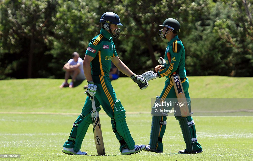 Murray Coetzee of South Africa (L) walks off after being dismissed during the 2nd U/19 Youth One Day International match between South Africa and England at Bellville Cricket Club on February 15, 2013 in Cape Town, South Africa.
