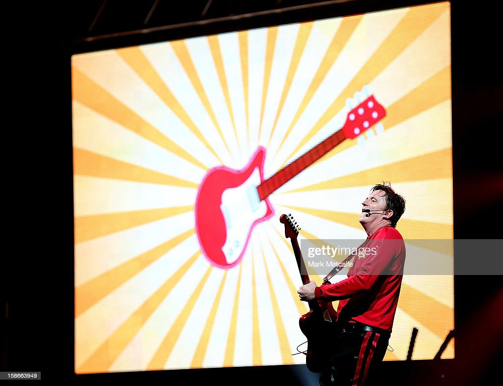 <a gi-track='captionPersonalityLinkClicked' href=/galleries/search?phrase=Murray+Cook&family=editorial&specificpeople=711239 ng-click='$event.stopPropagation()'>Murray Cook</a> of The Wiggles performs on stage during The Wiggles Celebration Tour at Sydney Entertainment Centre on December 23, 2012 in Sydney, Australia. This concert is the final time the original members of The Wiggles will perform on stage together as Greg, Murray and Jeff are retiring.