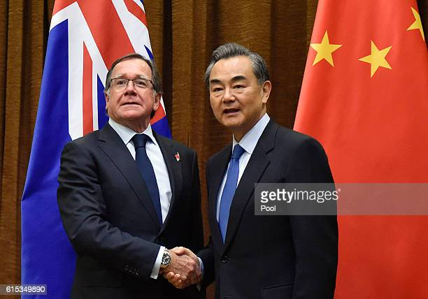 Murray McCully Foreign Minister of New Zealand shakes hands with Wang Yi Foreign Minister of China ahead of their meeting on October 18 2016 in...