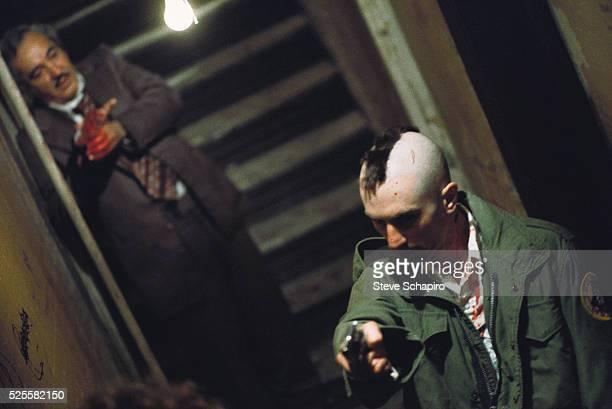 Murray Moston lurks behind Robert De Niro during Travis Bickle's killing spree in Martin Scorsese's Taxi Driver