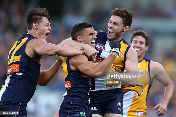 Murray Newman of the Eagles is congratulated by team mates after kicking a goal during the round 21 AFL match between the West Coast Eagles and...