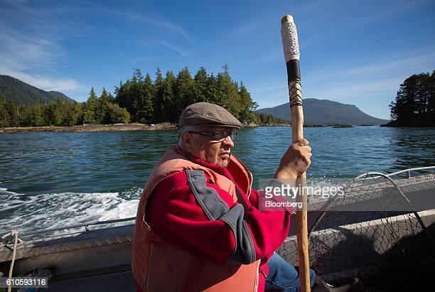 Murray Smith a member of the Lax Kw'alaams First Nation rides in a boat to protesters occupying Lelu Island near Prince Rupert British Columbia...