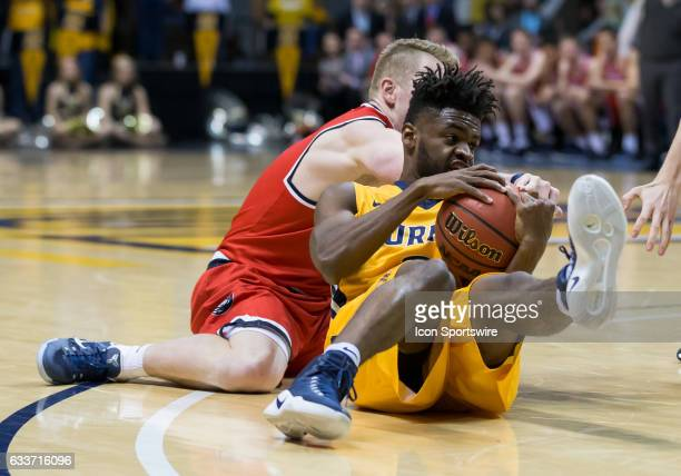 Murray State guard Jonathan Stark wrestles on the court with Belmont guard Austin Luke for a loose ball during a college basketball game between the...