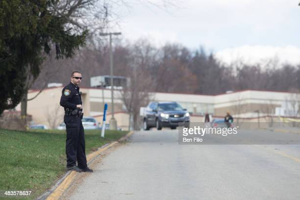 Murrysville Police Officer stands on the scene of a mass stabbing at Franklin Regional Senior High School April 9 2014 in Murrysville Pennsylvania A...