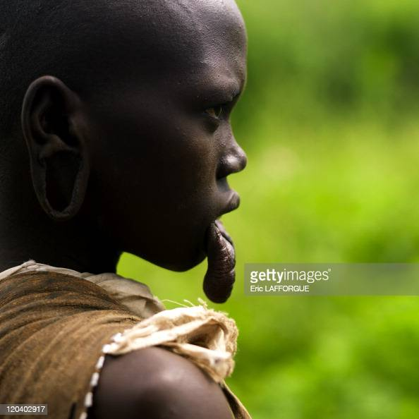 Mursi woman in Omo valley in Ethiopia on October 24 2008 Mursi can be found in the land between the Omo and Mago rivers Neighbored by the Surma Ari...