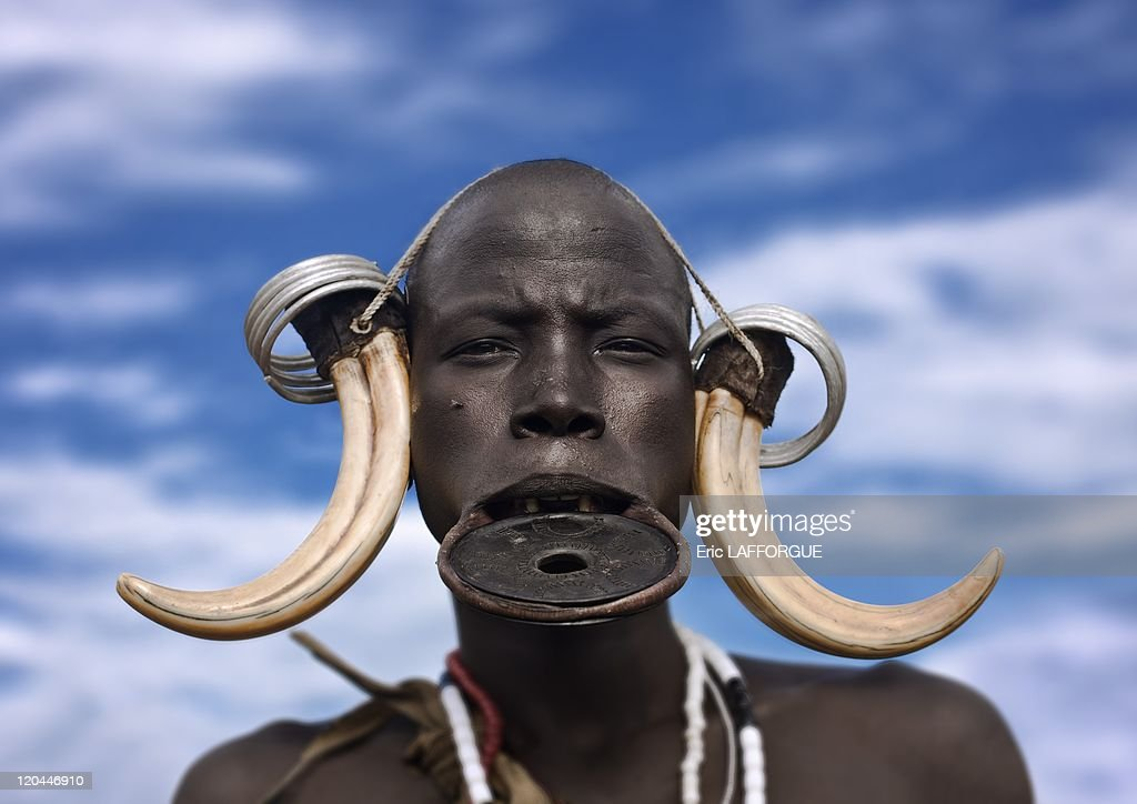 Mursi woman in Omo valley in Ethiopia on October 25 2008 Mursi can be found in the land between the Omo and Mago rivers Neighboured by the Burma Ari...
