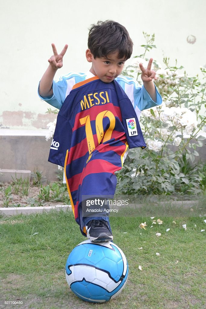 Murtaza Ahmedi, a five year old Afghan boy who wears a jersey signed by Messi, poses as he holds another jersey from Messi in Quetta of Balochistan province, a South-Western city in Pakistan on May 3, 2016. A boy from Ghazni province of Afghanistan became famous on social media in the world after wearing a plastic bag shirt resembling the uniform of international football star Lionel Messi. Messi had also expressed his wish to meet Murtaza Ahmedi. Parents of Murtaza Ahmedi moved him to Quetta from Afghanistan hence they worried about kidnapping, Mr. Wahid Ahmedi, a relative of the boy said. They also appealed to football federations and both Afghanistan and Pakistan government for making arrangements of meeting between Lionel Messi and Murtaza Ahmedi.