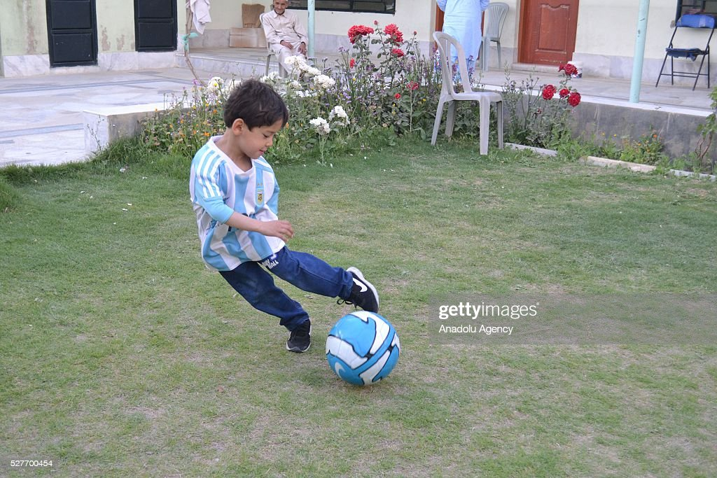 Murtaza Ahmedi, a five year old Afghan boy who wears a jersey signed by Messi, plays with a ball in Quetta of Balochistan province, a South-Western city in Pakistan on May 3, 2016. A boy from Ghazni province of Afghanistan became famous on social media in the world after wearing a plastic bag shirt resembling the uniform of international football star Lionel Messi. Messi had also expressed his wish to meet Murtaza Ahmedi. Parents of Murtaza Ahmedi moved him to Quetta from Afghanistan hence they worried about kidnapping, Mr. Wahid Ahmedi, a relative of the boy said. They also appealed to football federations and both Afghanistan and Pakistan government for making arrangements of meeting between Lionel Messi and Murtaza Ahmedi.