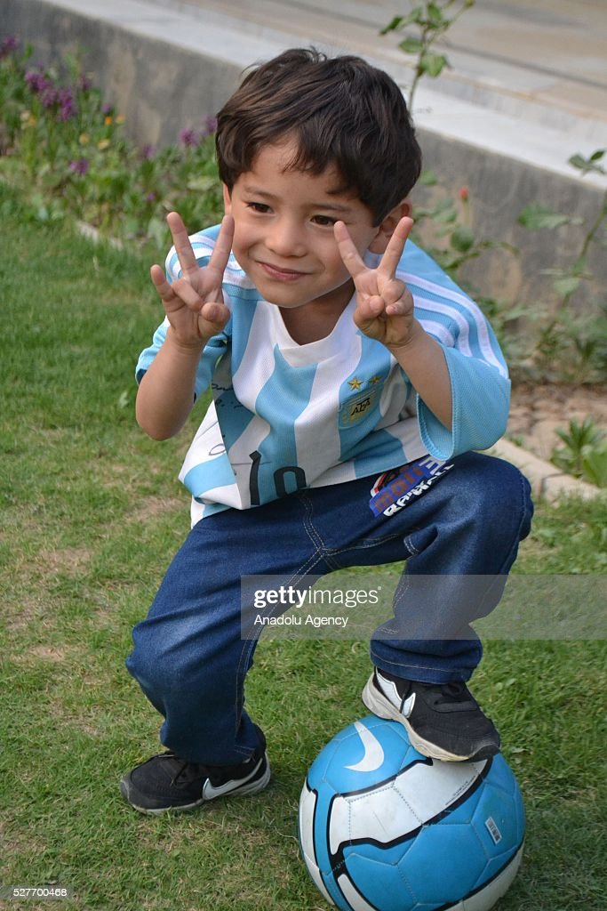 Murtaza Ahmedi, a five year old Afghan boy who wears a jersey signed by Messi, poses with a ball in Quetta of Balochistan province, a South-Western city in Pakistan on May 3, 2016. A boy from Ghazni province of Afghanistan became famous on social media in the world after wearing a plastic bag shirt resembling the uniform of international football star Lionel Messi. Messi had also expressed his wish to meet Murtaza Ahmedi. Parents of Murtaza Ahmedi moved him to Quetta from Afghanistan hence they worried about kidnapping, Mr. Wahid Ahmedi, a relative of the boy said. They also appealed to football federations and both Afghanistan and Pakistan government for making arrangements of meeting between Lionel Messi and Murtaza Ahmedi.