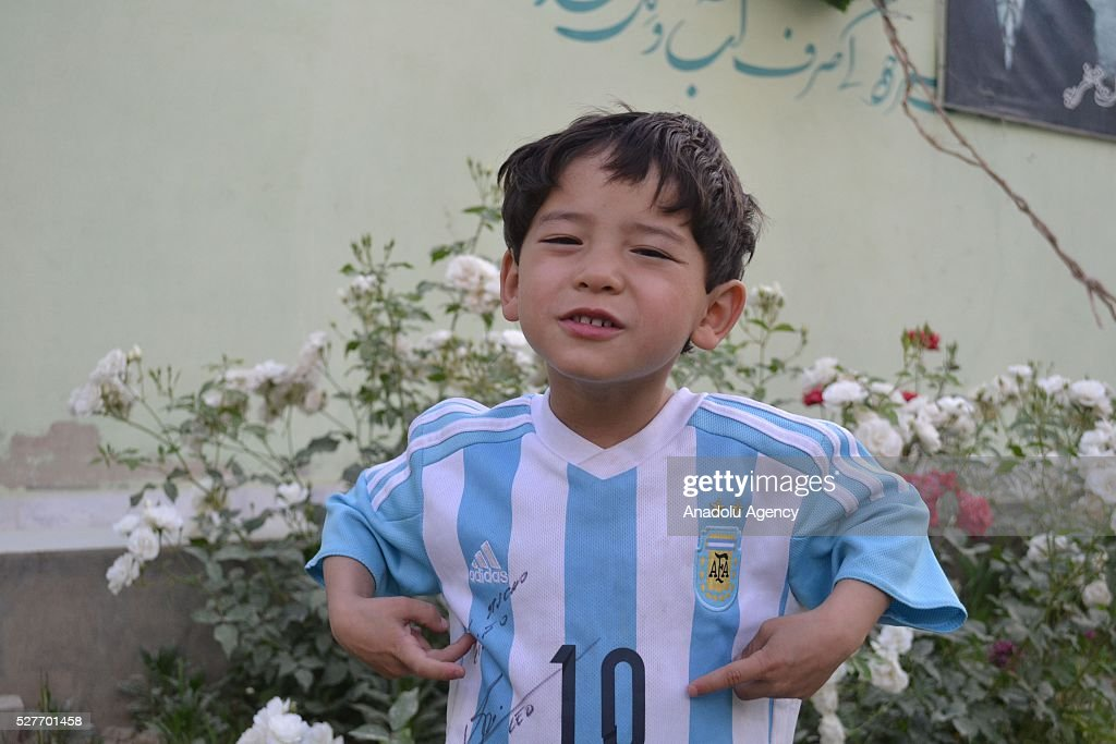Murtaza Ahmedi, a five year old Afghan boy who wears a jersey signed by Messi, poses in Quetta of Balochistan province, a South-Western city in Pakistan on May 3, 2016. A boy from Ghazni province of Afghanistan became famous on social media in the world after wearing a plastic bag shirt resembling the uniform of international football star Lionel Messi. Messi had also expressed his wish to meet Murtaza Ahmedi. Parents of Murtaza Ahmedi moved him to Quetta from Afghanistan hence they worried about kidnapping, Mr. Wahid Ahmedi, a relative of the boy said. They also appealed to football federations and both Afghanistan and Pakistan government for making arrangements of meeting between Lionel Messi and Murtaza Ahmedi.