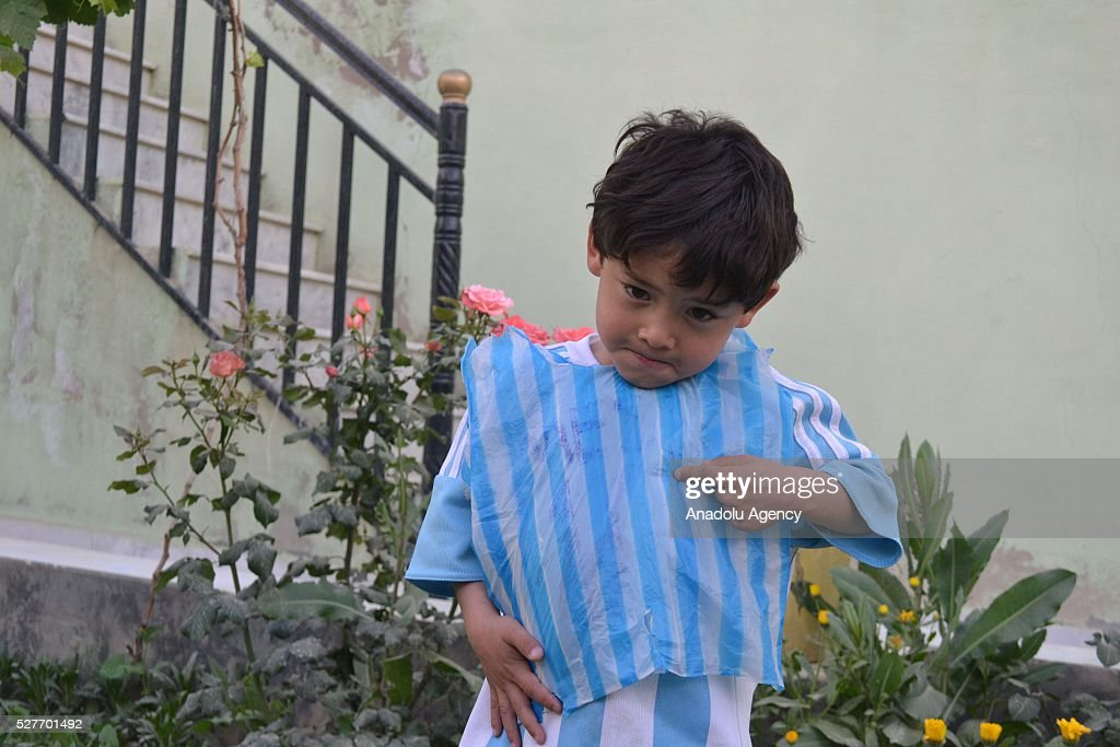 Murtaza Ahmedi, a five year old Afghan boy who wears a jersey signed by Messi, poses as he holds his plastic bag uniform in Quetta of Balochistan province, a South-Western city in Pakistan on May 3, 2016. A boy from Ghazni province of Afghanistan became famous on social media in the world after wearing a plastic bag shirt resembling the uniform of international football star Lionel Messi. Messi had also expressed his wish to meet Murtaza Ahmedi. Parents of Murtaza Ahmedi moved him to Quetta from Afghanistan hence they worried about kidnapping, Mr. Wahid Ahmedi, a relative of the boy said. They also appealed to football federations and both Afghanistan and Pakistan government for making arrangements of meeting between Lionel Messi and Murtaza Ahmedi.