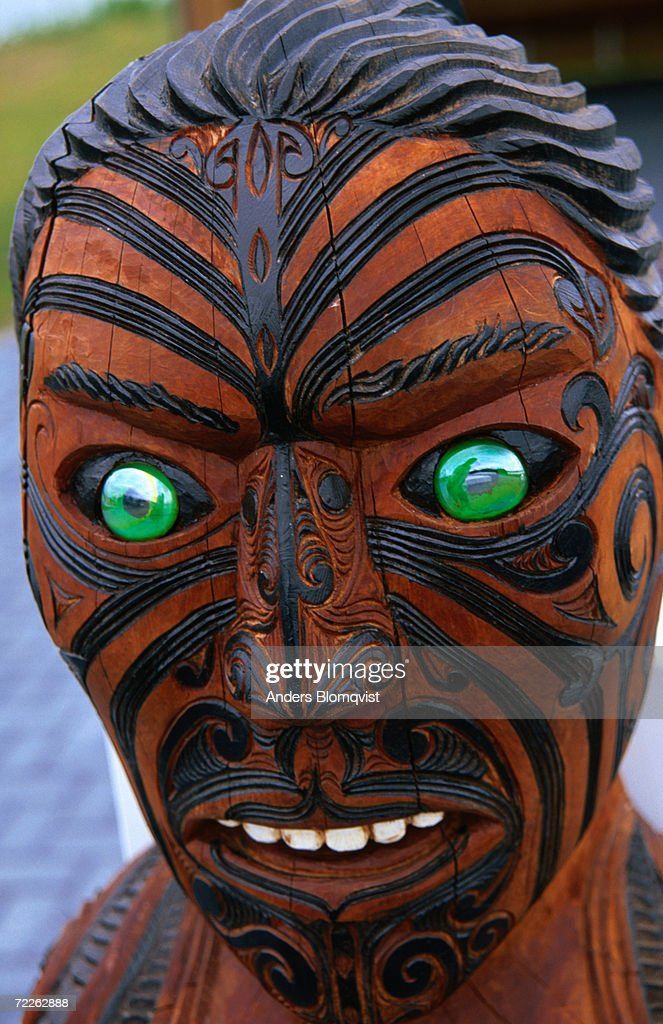 Muruika, a modern Maori carving with glowing green eyes, Rotorua, New Zealand : Stock Photo