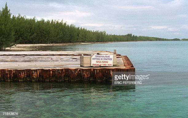 This picture taken 06 June 2000 shows a landing stage at Fangataufa atoll French Polynesia with a board reading in French and Thaitian 'Military zone...