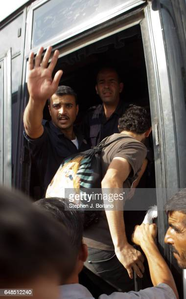 Musa Mahameed age 19 from Daara Syria boards a bus in the Zaatari Refugee Camp Jordan in preparation for return to Syria He boarded the bus to the...