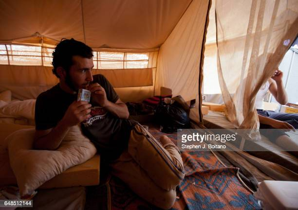 Musa Mahameed age 19 from Daara Syria eats in his tent in the Zaatari Refugee Camp Jordan in preparation for return to Syria He boarded a bus to the...