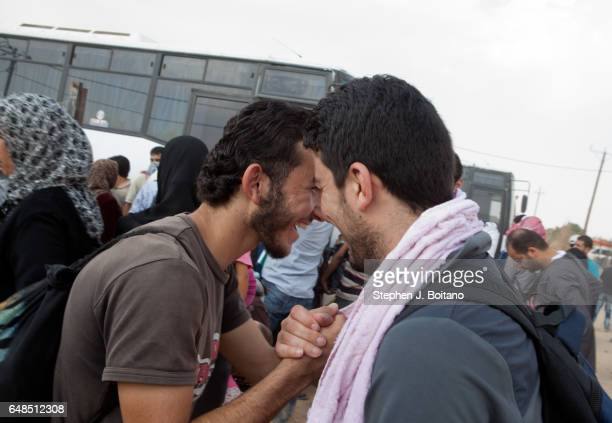 Musa Mahameed age 19 from Daara Syria says goodbye to friends in the Zaatari Refugee Camp Jordan in preparation for return to Syria He boarded a bus...