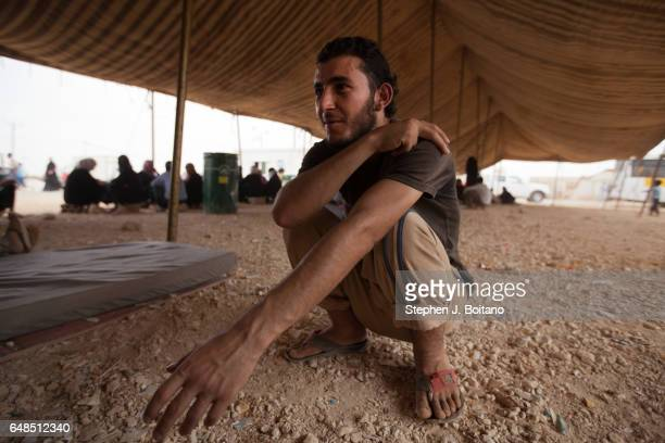 Musa Mahameed age 19 from Daara Syria speaks with friends in the Zaatari Refugee Camp Jordan in preparation for return to Syria He boarded a bus to...