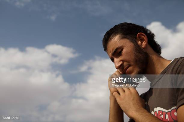 Musa Mahameed age 19 from Daara Syria speaks with his crying wife in the Zaatari Refugee Camp Jordan in preparation for return to Syria He boarded a...