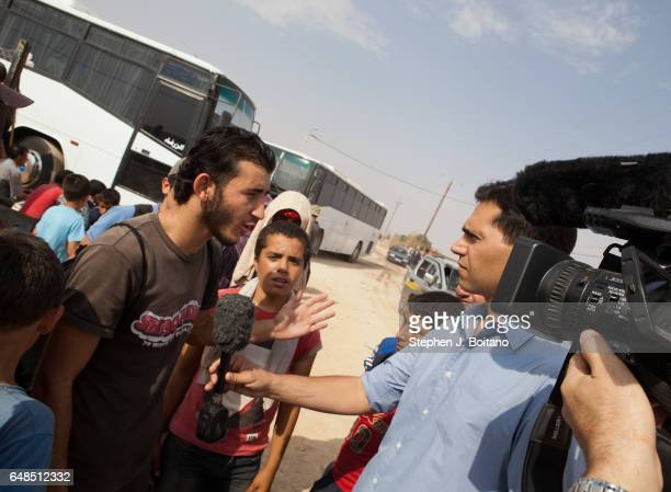 Musa Mahameed age 19 from Daara Syriais interviewed by the media in the Zaatari Refugee Camp Jordan in preparation for return to Syria He boarded a...