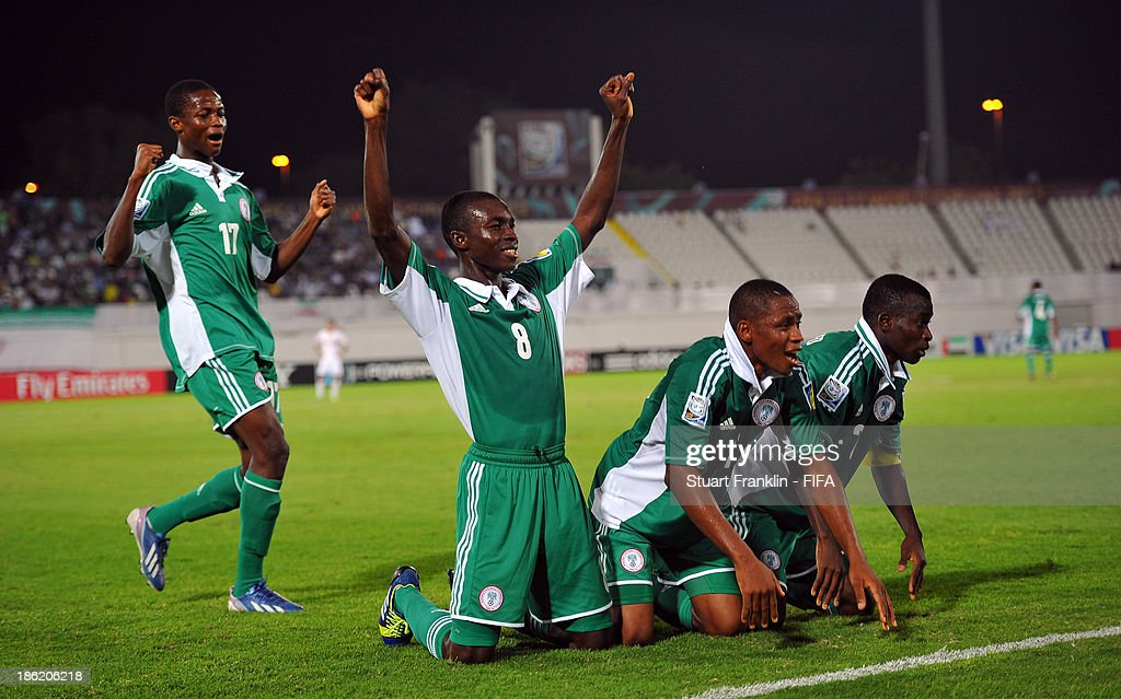 Musa Muhammed of Nigeria celebrates scoring his goal with teamates during the round of 16 match between Nigeria and Iran at Khalifa Bin Zayed Stadium on October 29, 2013 in Al Ain, United Arab Emirates.