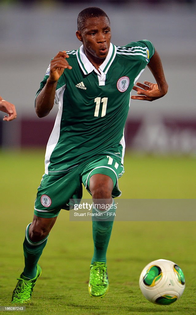 Musa Yahaya of Nigeria in action during the round of 16 match between Nigeria and Iran at Khalifa Bin Zayed Stadium on October 29, 2013 in Al Ain, United Arab Emirates.