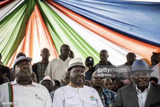 Musalia Mudavadi principal of theNational Super Alliance left and Raila Odinga opposition leader for the National Super Alliance center look on...