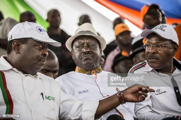 Musalia Mudavadi principal of theNational Super Alliance left speaks with Raila Odinga opposition leader for the National Super Alliance center and...