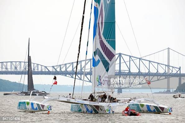 MusandamOman Sail and Spindrift 2 sail on the St Lawrence River on July 13 2016 for the Transat Quebec SaintMalo race in Quebec City Every four years...