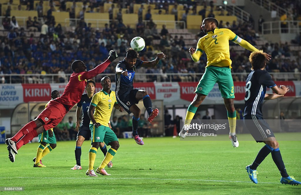 Musashi Suzuki of Japan and Nkosingiphile Gumede of South Africa compete for the ball during the U-23 international friendly match between Japan and South Africa at the Matsumotodaira Football Stadium on June 29, 2016 in Matsumoto, Nagano, Japan.