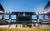 Muscian Taylor Hicks performs the national anthem as planes fly overhead at the Opening Day MLB game between the Arizona Diamondbacks and the San...
