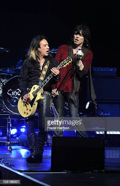 Muscians Jeff LaBar and Tom Keifer of Cinderella performs At The Nokia Theatre At LA Live on July 31 2010 in Los Angeles California