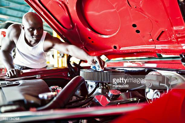 muscle car being cleaned by owner