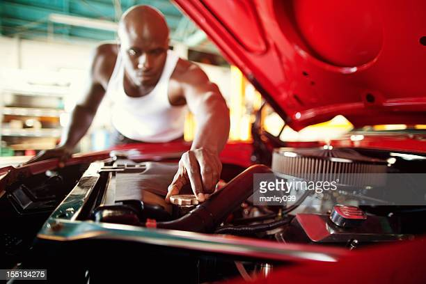 muscle car owner working on vintage vehicle