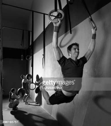 Muscle ups rings man swinging workout at gym : Stock Photo