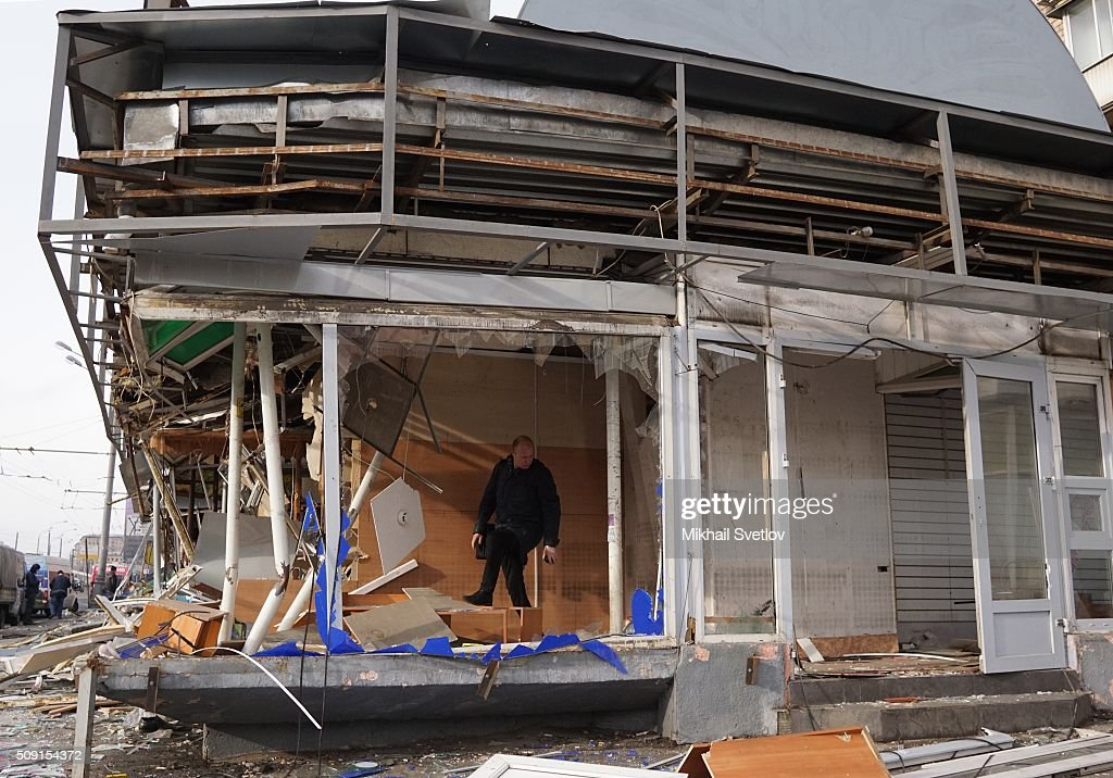 A Muscovite inspects a demolished private trade pavilion in the center on February 9, 2016 in Moscow, Russia. New Moscow authorities have ordered 97 shopping centers, trade pavilions, street kiosks and stalls built without legal documentation near metro stations to be removed, stating they may harm transport infrastructure engineering communications. Large-scale demolition of kiosks and small shopping centers began on Monday night with 55 percent of the properties having been completely removed by Tuesday morning.