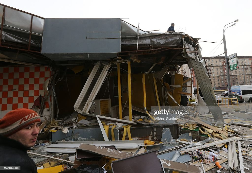 A Muscovite looks at a demolished private trade pavilion in the center on February 9, 2016 in Moscow, Russia. New Moscow authorities have ordered 97 shopping centers, trade pavilions, street kiosks and stalls built without legal documentation near metro stations to be removed, stating they may harm transport infrastructure engineering communications. Large-scale demolition of kiosks and small shopping centers began on Monday night with 55 percent of the properties having been completely removed by Tuesday morning.