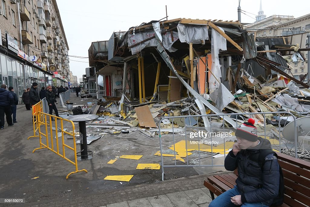 Muscovites pass by a demolished private trade pavilion in the center on February 9, 2016 in Moscow, Russia. New Moscow authorities have ordered 97 shopping centers, trade pavilions, street kiosks and stalls built without legal documentation near metro stations to be removed, stating they may harm transport infrastructure engineering communications. Large-scale demolition of kiosks and small shopping centers began on Monday night with 55 percent of the properties having been completely removed by Tuesday morning.