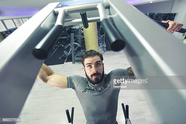 Muscular athlete doing pullups