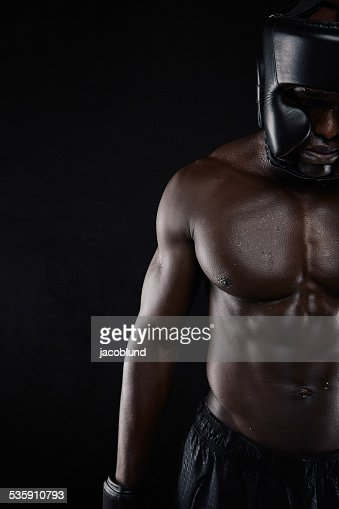 Muscular body of african male boxer : Stock Photo